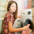 Teenager girl doing laundry — Stock Photo #6041589