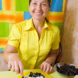 Woman mixing prune and ric — Stock Photo