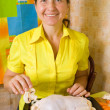 Royalty-Free Stock Photo: Woman adds mushrooms to  stuffed chicken