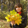 Girl with maple leaves — Stock Photo