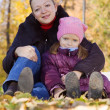 Woman with girl in autumn — Stock Photo
