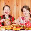 Women  eating pancake during  Shrovetide — Stock Photo