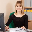Businesswoman on her workplace in office — Stock Photo #6042860