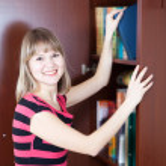 Happy girl selecting book — Stock Photo #6042996