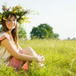 Girl in flowers wreath — Stock Photo