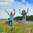 Teenager jumping at meadow — Stock Photo