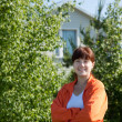 Happy woman in front of her residence — Stock Photo #6044112