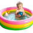 Baby swimming  in kid inflatable pool — Stock Photo