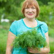 Woman with harvested dill — Stock Photo #6044623