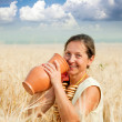 Eldery woman with jug — Stockfoto