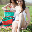 Two women relaxing in grass — Stock Photo