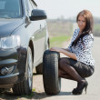 Woman changing car wheel — Stock Photo #6045014