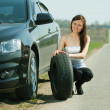 Woman during wheel changing — Stock Photo #6045016