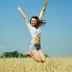 Jumping girl at field — Stock Photo
