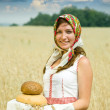 Girl with bread at field — Stock Photo #6045137