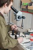 Jeweller working with microscope — Stock Photo