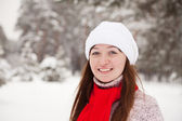 Sporty girl at winter park — Stock Photo