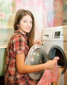 Teenager girl doing laundry — Stock Photo