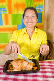 Woman with baked chicken — Stock Photo