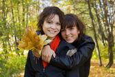 Two girls in autumn — Stock Photo