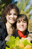 Girls in autumn park — Stock Photo
