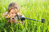 Girl aiming an air rifle — Stock Photo