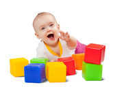 Happy baby plays with toy blocks — Stock Photo