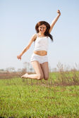 Jumping mid adult woman — Stock Photo
