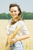Girl with wheat ears — Stock Photo