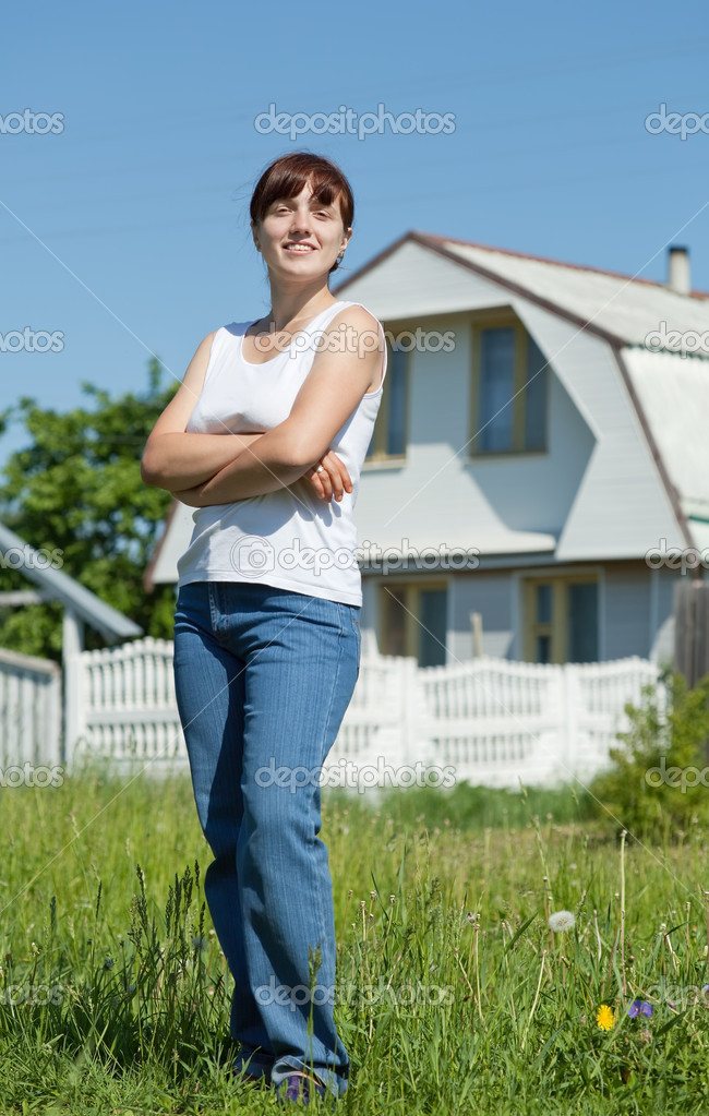 Happy young woman posing in front of her  residence — Stock Photo #6040050