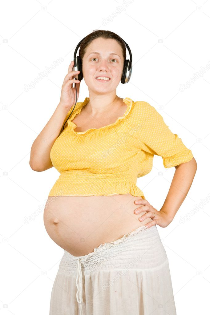 Pregnant woman with headphones. Isolated over white  — Stock Photo #6040429
