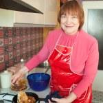 Woman cooking pancakes — Stock Photo #6051214