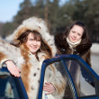 Two happy women with car — Stock Photo