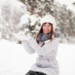Woman throwing snow — Stock Photo