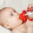 Baby girl with baby bottle — Stock Photo #6053360
