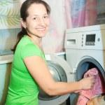 Mature woman doing laundry — Stock Photo #6053381