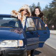 Women with car — Stock Photo