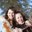 Happy girls in winter park — Stock Photo