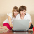 Wonder girls looking to laptop — Stock Photo #6054112