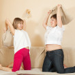Happy girls playing with pillows — Stock Photo #6054121