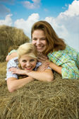Country girls on hay — Stock Photo