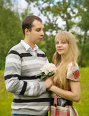 Couple in love with flower — Stock Photo