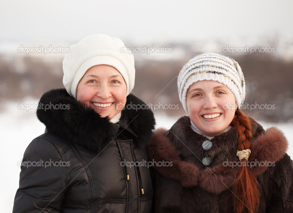 Portrait of two happy women in winter park  Stock Photo #6053386