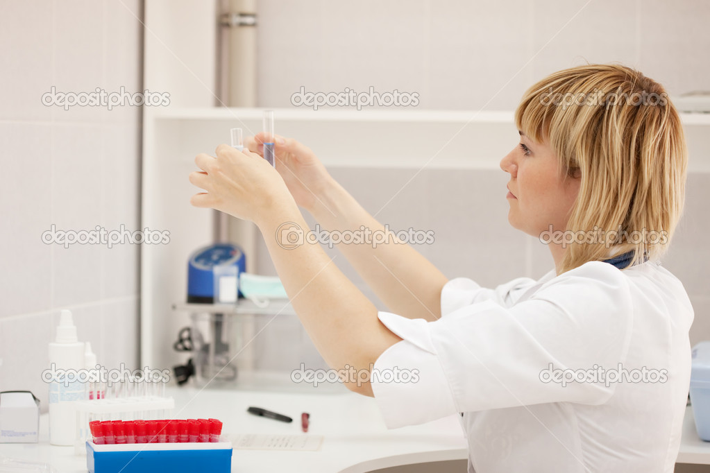 Woman doctor with test tube in laboratory — Stock Photo #6068425