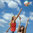 Girls playing volleyball — Stock Photo
