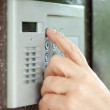 Close-up of using intercom — Stock Photo #6215618