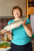 Mature woman with fish — Stock Photo