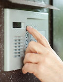Close-up of using intercom — Stock Photo