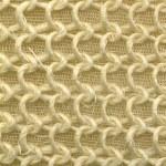 Yellow texture of foam rubber macro — Stock Photo
