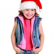 Little girl in denim suit and a hat of Santa Claus — Stock Photo #6208544